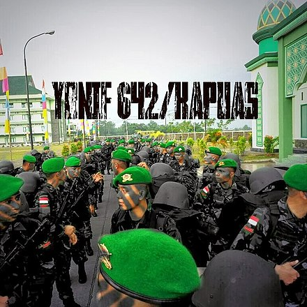 Indonesian Army Infantry soldiers from the 642nd Infantry Battalion line up before deployment to the international Border of Indonesia and Papua New Guinea in 2013 for border patrol operations in dense forests and mountainous terrain YON 642.jpg