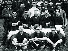 Players and staff pose for a photograph