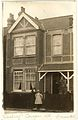 Young girl outside house on Cowper Road, Hanwell ca 1910 (7605595866).jpg