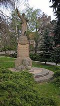 Čečelice - pomník Karla Havlíčka Borovského před kostelem.jpg