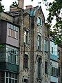 Фрвгмент фасаду із заскленими балконами.jpg