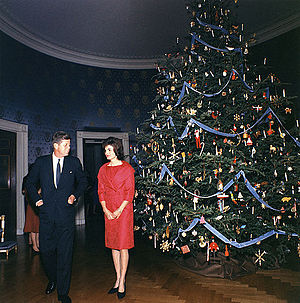 White House Christmas tree - President John F. Kennedy and First Lady Jacqueline Kennedy with the first themed Blue Room tree in 1961.