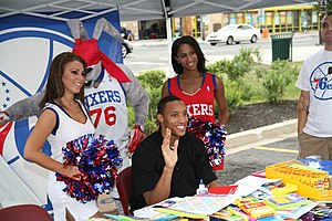 Evan Turner - Turner with cheerleaders and the team mascot