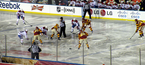 be156b941 The Flames and Canadiens line up for a faceoff at the Heritage Classic