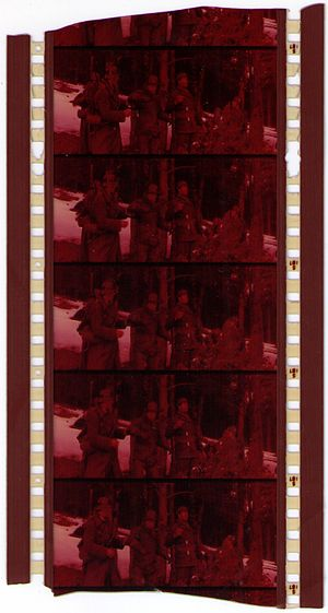 70 mm film - Faded vintage 70 mm positive film with 4 magnetic strips containing 6-channel stereo sound