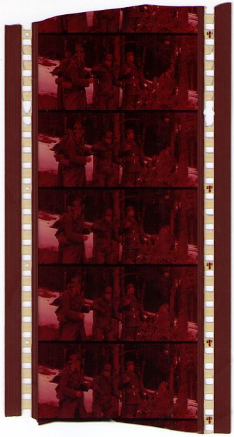 70 mm film - Faded vintage 70 mm positive film with four magnetic strips containing six-channel stereophonic sound