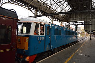 """Les Ross - BR Class 86 no 86259 """"Les Ross"""" departing Preston with her owner Les Ross onboard in her rear cab."""