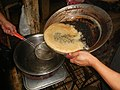 9129Processing and cooking of coconut healing oil in the Philippines 44.jpg