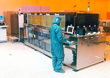 English: Scientist working on stiched wafers, ...