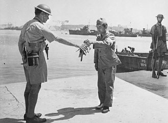 British Commonwealth Occupation Force - 30 August 1945. Yokosuka Naval Base, Tokyo Bay. Commander Yuzo Tanno hands over the keys of the Yokosuka Naval Base to Captain H. J. Buchanan, Royal Australian Navy. Buchanan led the first British Commonwealth party to go ashore in Japan.