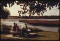 A FAMILY ENJOYS A PICNIC BESIDE THE BUENA VISTA LAGOON. THE BODY OF WATER IS AN EXCELLENT BIRD REFUGE, BUT IS... - NARA - 557488.tif