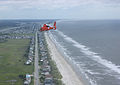 A U.S. Coast Guard MH-65 Dolphin helicopter from Air Station Savannah, Ga., approaches Wilmington National Airport in Wilmington, N.C., Aug 110827-G-OD102-113.jpg