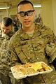 A U.S. Soldier with the 5th Battalion, 25th Field Artillery Regiment carries his Thanksgiving dinner at Forward Operating Base Fenty in Nangarhar province, Afghanistan, Nov. 28, 2013 131128-A-CB167-005.jpg