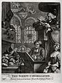 A clergyman reads the sermon with the aid of a magnifying gl Wellcome V0049236.jpg