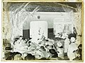 A crowd gathered outside a Plunket room (AM 80043-2).jpg