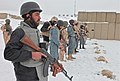 A group of Afghan Uniformed Police officers wait for the command to fire downrange while Czech military police instructors watch and assist them at Swanson Small-Arms Range on Forward Operations Base Shank 120201-A-BZ540-054.jpg
