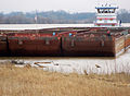 A tugboat and its barges on the Ohio River.jpg