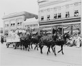 A wagon pulled by four mules, passing before a reviewing stand (not visible) on which President Harry S. Truman was... - NARA - 199902.tif
