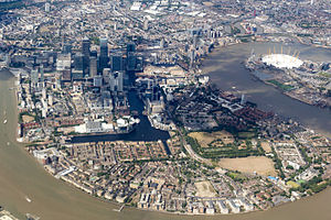 Isle of Dogs - Aerial view the Isle of Dogs in 2015. The O2 Arena can be seen on the Greenwich Peninsula to the right (east) of the Isle of Dogs.