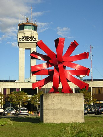 José María Córdova International Airport - Sculpture El Sol by Edgar Negret in the foreground and control tower in the background