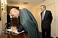 Afghan President Hamid Karzai signs the guest book at the Pentagon, 2004.jpg