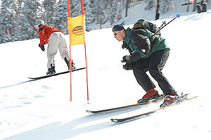 Nearly 200 skiers and snowboarders participate...