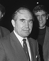 Alf Ramsey wearing a dark suit, a white shirt and a dark tie