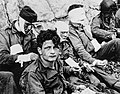 American Assault Troops of the 16th Infantry Regiment, Injured While Storming Omaha Beach, Wait by the Chalk Cliffs for Evacuation to a Field Hospital for Further Medical Treatment, Collville-sur-Mer, Normandy, France - NARA - 531187.jpg