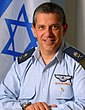 Amir Eshel with flag of Israel.jpg