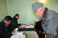 An old man voter registering his name at a polling booth in '15 miles', Tsomgo (Changu) lake, Sikkim during the third phase of General Election-2009 on April, 30, 2009.jpg