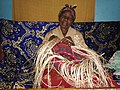 An old woman weaving a 'kiondo'.jpg
