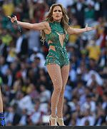 Jennifer Lopez onstage in a brief, green outfit
