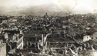 Shusha massacre - Armenian half of Shusha destroyed by Azerbaijani armed forces in 1920, with the defiled cathedral of the Holy Savior and Aguletsots church on the background