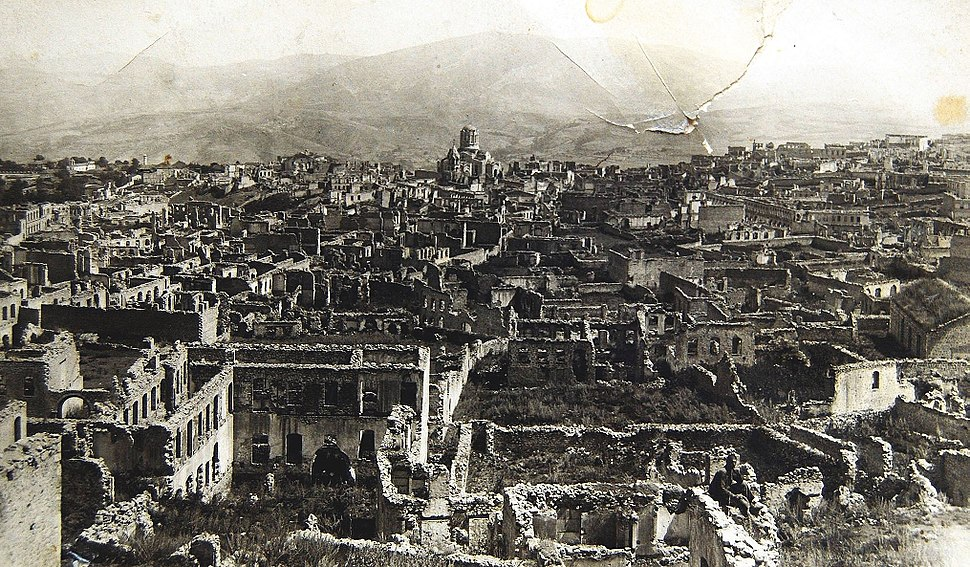 Armenian boroughs of city of Shusha destroyed by Azerbaijani armed forces in 1920 with defiled cathedral of Holy Savior on background