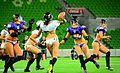 Attempting to make a pass - Victoria Maidens vs. Western Australia Angels - Legends Football League - 14 Dec. 2013.jpg
