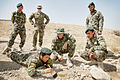Australian Army Lt. Dominic Santilli, back row, center, an engineer advisor with the Security Forces Assistance Team, and Afghan soldiers watch Sgt. Mohammed Hasan, with the Afghan National Army 4th Brigadek 130611-A-MD709-087.jpg