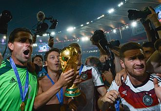 Silvio Gazzaniga - Germany's Mesut Özil holds the FIFA World Cup trophy designed by Gazzaniga after the 2014 World Cup Final