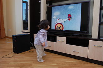 Early childhood education - Image: Az girl at the TV, e citizen