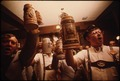 BEER STEINS ARE RAISED AS THE CONCORD SINGERS PRACTICE SINGING GERMAN SONGS IN NEW ULM, MINNESOTA. THEY ARE TRYING TO... - NARA - 558266.tif