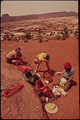 Backpackers Terry Mcgaw, Glen Denny and Steve Miller Sorting Out Food on a Week - Long Hiking Trip through Water Canyon and the Maze, a Remote and Rugged Region without Footpaths in the Heart of the Canyonlands, 05-1972 (3814976302).jpg
