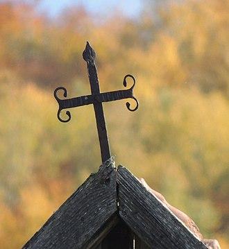Strigoi - A barn cross on a farm outbuilding in Transylvania.