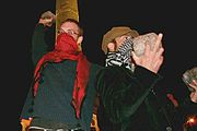 Rioters typically wear face masks, scarves, and other headgear, in order not to be recognizable and in order to filter tear gas; they may use cobblestones as projectiles
