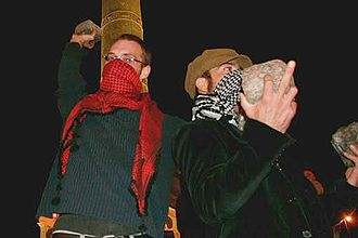 Riot - Rioters wearing scarves to conceal their identity and filter tear gas.
