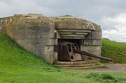 One of the casemates of the Longues-sur-Mer battery in Normandy, destroyed by naval gunfire during the Allied landings Batterie Longues-sur-Mer bunker gun 2.jpg
