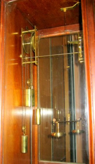 Beverly Clock - The inner mechanism of the Beverly clock showing chain, sprockets and torsional pendulum