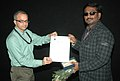 Bhupendra Khaintola felicitated the Director, Shri G. Vasanta Balan, at the presentation of the film (Angadi Theru), in the INOX Cinema Hall, during the IFFI-2010, in Panjim, Goa on November 27, 2010.jpg
