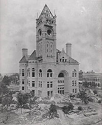 Courthouse building under construction with clock–tower but no clock