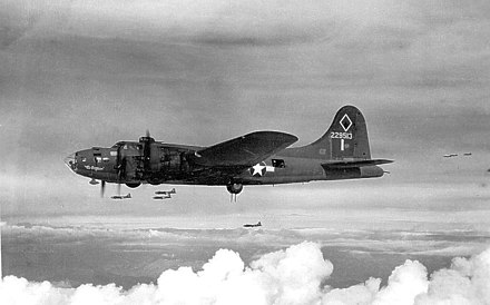 A B-17F of the 99th Bomb Group, with the nearly frameless clear-view bombardier's nose Boeing B-17F 42-29513 in flight, 1943.jpg