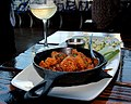Buffalo shrimp served in cast iron pan.jpg