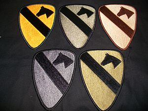 Shoulder sleeve insignia -  Example of the five current types of shoulder sleeve insignia for the U.S. 1st Cavalry Division; full color, BDU subdued, desert subdued, UCP subdued, OCP subdued